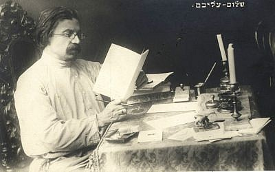 Famed Yiddish author Shalom Aleichem, whose centennial yahrzeit was May 22, 2016, seated at his writing desk. (Courtesy YIVO Institute for Jewish Research)
