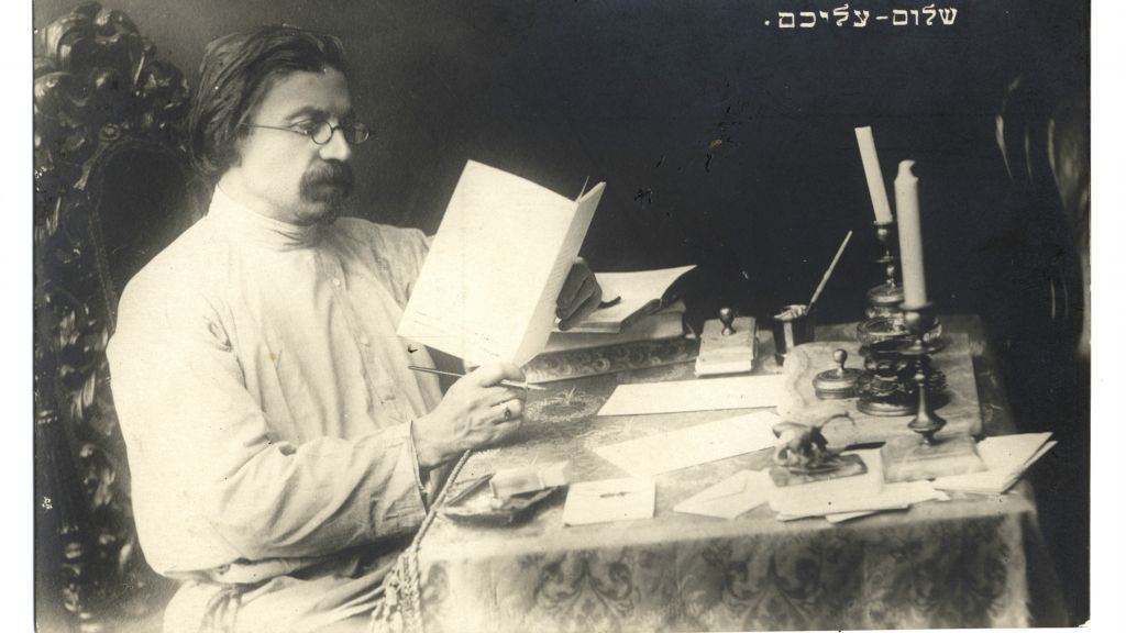 Famed Yiddish author Shalom Aleichem, whose centennial yahrzeit was May 22, 2016, seated at his writing desk (courtesy YIVO Institute for Jewish Research)