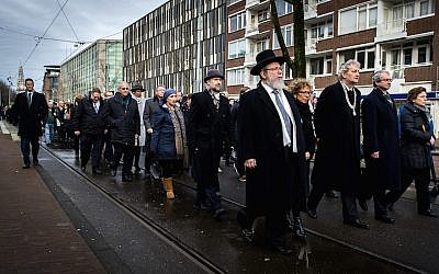 Illustrative: Mayor of Amsterdam Eberhard van der Laan (4th R) leads a march from City Hall to the Auschwitz monument in the Wertheimpark in Amsterdam on January 26, 2014, during the national memorial day for the victims of the Holocaust. (AFP Photo/ANP/Remko de Waal via JTA)