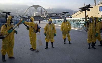 In this Tuesday, Jan. 26, 2016 file photo, health workers get ready to spray insecticide to combat the Aedes aegypti mosquitoes that transmits the Zika virus, under the bleachers of the Sambadrome in Rio de Janeiro, used for the Archery competition in the 2016 summer games. (AP/Leo Correa, File)
