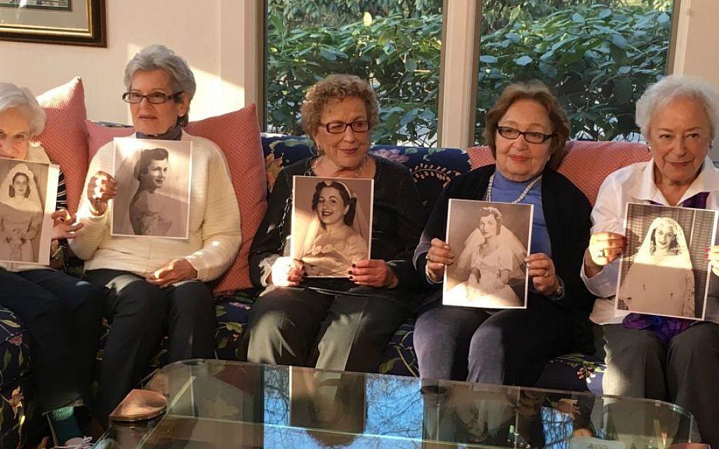 The Bridge Ladies holding their wedding photos. Left to right: Bea Phillips, Bette Horowitz, Roz Lerner, Jackie Podoloff, Rhoda Meyers (Hannah Robinson)