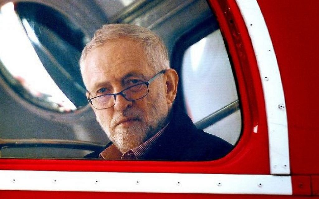 Britain's Labour Party leader Jeremy Corbyn sits aboard a London bus as he waits to address the crowd at a May Day rally in central London, May 1, 2016. (Anthony Devlin/PA via AP)