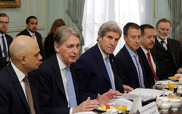 US Secretary of State John Kerry, center, and Britain's Foreign Secretary Phillip Hammond, second left, attend a meeting in central London, Thursday May 12, 2016. (Paul Hackett/Pool via AP)