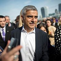 Newly elected London Mayor Sadiq Khan is greeted by well wishers outside City Hall in London, on his first day as mayor, May 9, 2016. (Jonathan Brady/PA via AP)