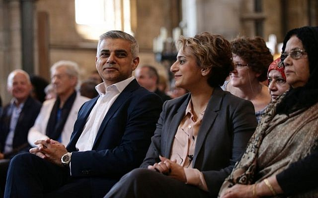 London's new mayor Sadiq Khan and his wife Saadiya attend the official signing ceremony in Southwark Cathedral, London, Saturday May 7, 2016.  (Yui Mok/Pool via AP)