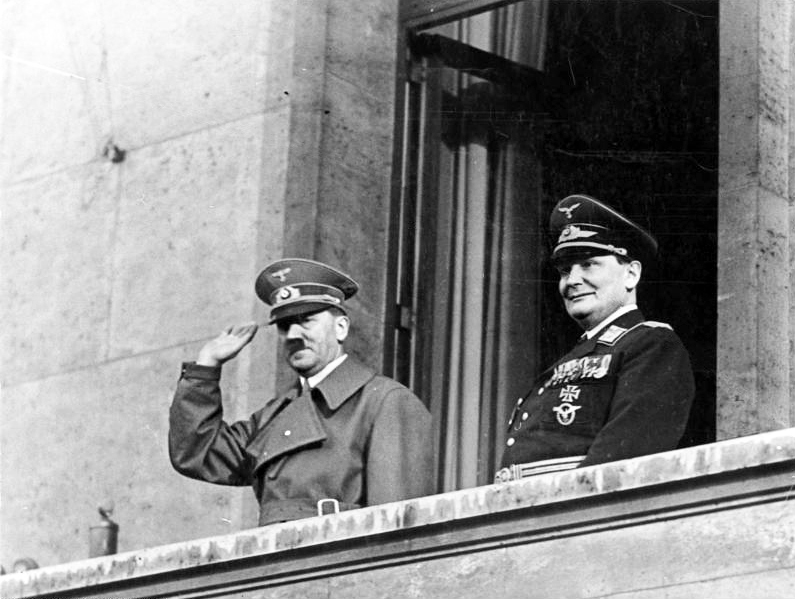 Adolf Hitler with Hermann Göring on balcony of the Chancellery, Berlin, 16 March 1938 (Bundesarchiv, Bild / Wikipedia)