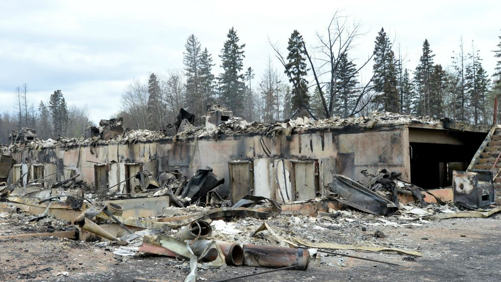 A burned out structure is viewed in the Abasands neighborhood during a media tour of the fire-damaged city of Fort McMurray, Alberta, Monday, May 9, 2016. (Jonathan Hayward/The Canadian Press via AP)