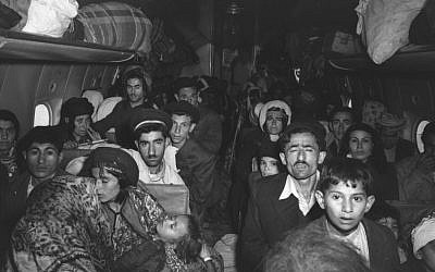 A plane filled with Iraqi Jews photographed on arrival at Lod Airport in early 1951 (Teddy Brauner, GPO)