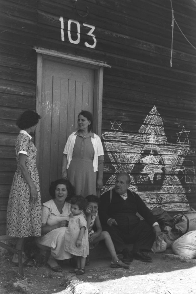 An Iraqi Jewish family at the Atlit transit camp in northern Israel hours after arrival in Israel, summer 1951 (Teddy Brauner, GPO)