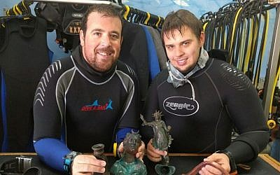The divers, Ran Feinstein, right, and Ofer Ra'anan after the discovery. (The Old Caesarea Diving Center)