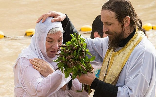 A baptism at the Qasr al-Yahud holy site on the Jordan River, where many Christian denominations believe Jesus was baptized. (HALO Trust)