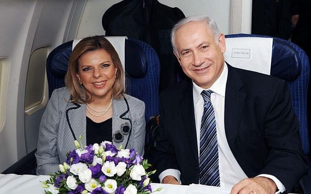 Prime Minister Benjamin Netanyahu and his wife, Sara, sit aboard a plane at Ben Gurion Airport on on 24 August 2009 (Amos Ben Gershom/GPO/Flash90)