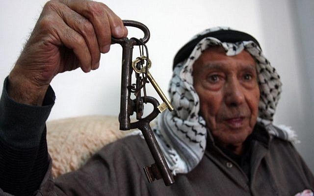 """A Palestinian refugee holds a keys which belonged to his previous home, a day before Palestinians mark the """"Nakba"""" or """"catastrophe,"""" a reference to the birth of the state of Israel in Ramallah on May 14, 2012. (Issam Rimawi/Flash90)"""
