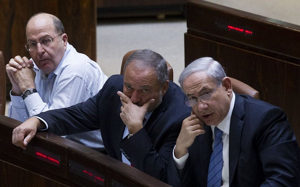 Prime Minister Benjamin Netanyahu, right, Avigdor Liberman, center, and Defense Minister Moshe Ya'alon in the Knesset on November 12, 2014. (Miriam Alster/FLASH90)