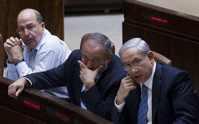 Prime Minister Benjamin Netanyahu, right, Avigdor Liberman, center, and Defense Minister Moshe Ya'alon in the Knesset on November 12, 2014. (Miriam Alster/FLASH90)