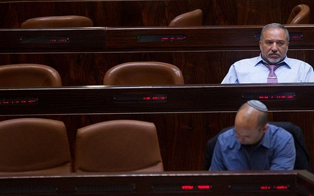 Yisrael Beytenu party leader Avigdor Liberman (back) and Jewish Home party leader Naftali Bennett (front) seen during a Knesset session on May 11, 2015. (Miriam Alster/Flash90)