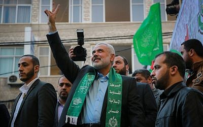 Senior Hamas leader Ismail Haniyeh gestures to the crowd as he takes part in a rally marking the 28th anniversary of Hamas's founding, in Gaza City on December 14, 2015. (Emad Nassar/Flash90)