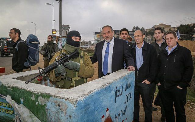Avigdor Liberman, in tie, at Etzion Junction in the West Bank on December 27, 2015. (Gershon Elinson/Flash90)