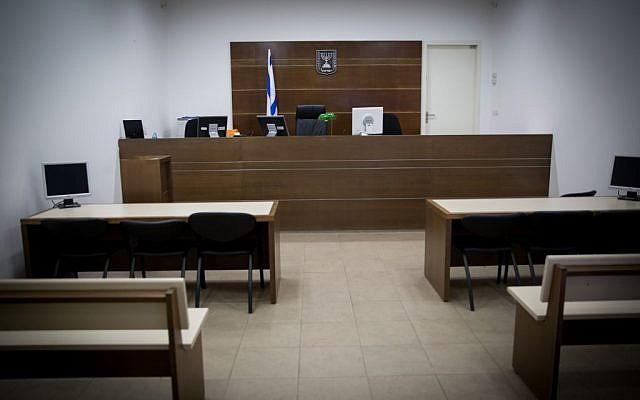 Illustration of God either present or not in a magistrate's courtroom, January 18, 2016. (Nati Shohat/FLASH90)
