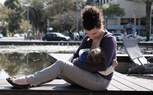 An illustrative photo of a woman breastfeeding her baby. (Tomer Neuberg/Flash90)