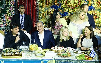 Prime Minister Benjamin Netanyau and his wife Sara attend the Jewish Moroccan celebration of Mimouna, in Yavne on April 30, 2016. (Flash90)