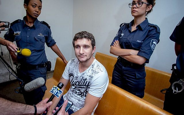 Serial murder and rape suspect Fydor Beijanri seen at Haifa magistrate's court on May 2, 2016 (Basel Awidat/FLASh90)