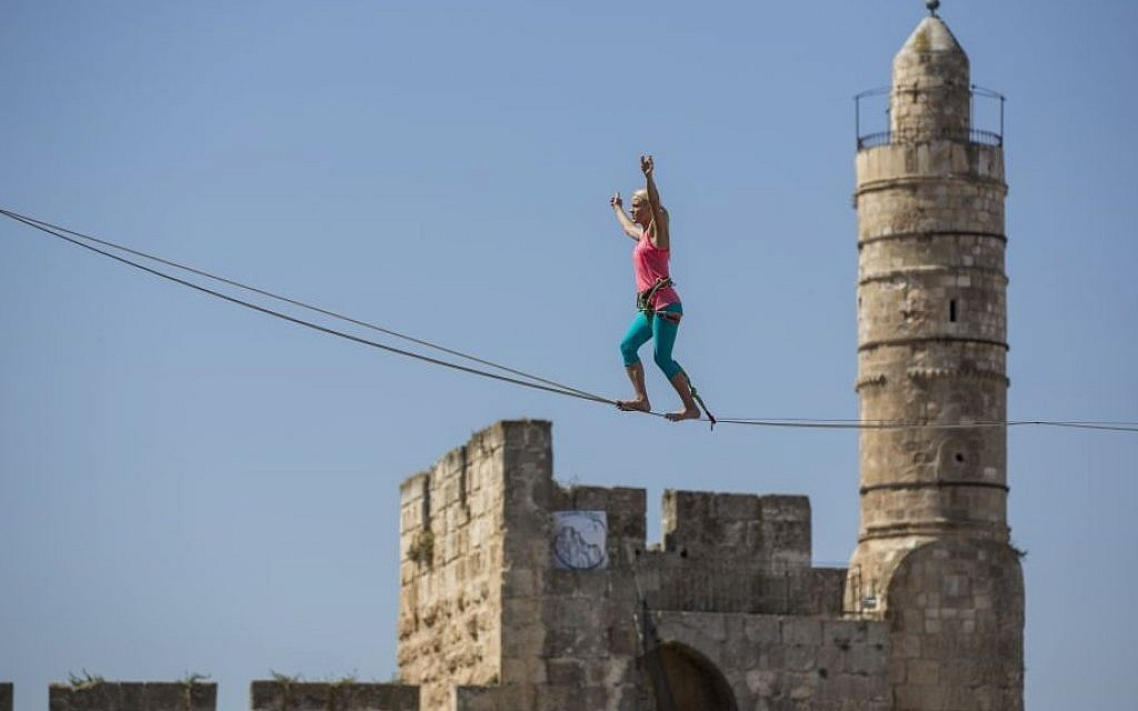 Slackliner Heather Larsen makes her way between two ancient citadels at Jerusalem's Tower of David Museum on May 2, 2016 (Yonatan Sindel/Flash90)