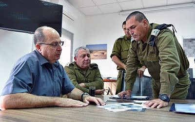 Defense Minister Moshe Ya'alon (left), IDF Chief of Staff Gadi Eisenkot (center) and GOC Southern Command Eyal Zamir (right) meet at the Southern Command headquarters near the Israeli border with Gaza on May 5, 2016. (Ariel Hermoni/Ministry of Defense)