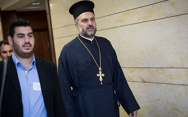 Father Gabriel Naddaf, right, seen at the Knesset on May 9, 2016. (Hadas Parush/Flash90)