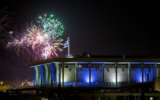 Fireworks from the Mount Herzl ceremony seen over the Knesset in Jerusalem, marking the beginning of celebrations of Israel's 68th Independence Day, May 11, 2016. (Yonatan Sindel/Flash90)