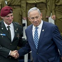Prime minister Benjamin Netanyahu, right, shakes hands with IDF Deputy Chief of Staff Maj. Gen. Yair Golan at a ceremony for outstanding soldiers on Israel's 68th Independence Day celebrations, at the President's Residence in Jerusalem, May 12, 2016. (Yonatan Sindel/Flash90)