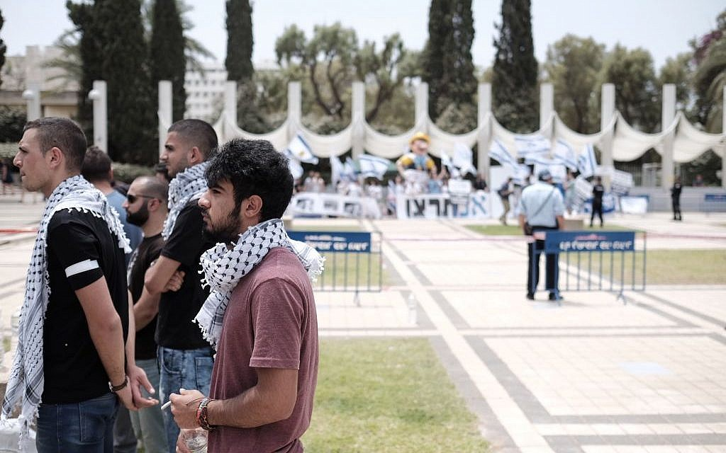 Arab Israeli and left wing student activists hold a memorial service during a rally marking the Nakba anniversary at the Tel Aviv University in Tel Aviv on May 15, 2016. (Tomer Neuberg/Flash90)