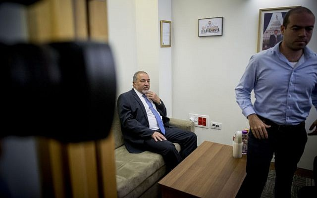 Avigdor Liberman meets with Tourism Minister Yariv Levin during coalition talks at the Knesset, the Israeli parliament in Jerusalem, May 19, 2016. (Yonatan Sindel/Flash90)