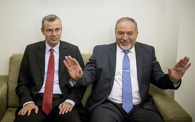 Avigdor Liberman, left, and Yariv Levin during coalition talks on the morning of May 19, 2016. (Yonatan Sindel/Flash90)