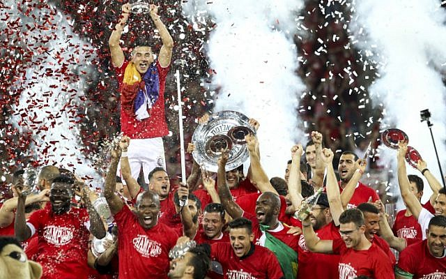Hapoel Beersheba F.C. soccer players celebrate after winning the Israeli League championship for the first time in 40 years in Beersheba on May 21, 2016. (Danny Meron/Flash90)