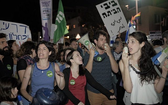 Activists protest at Habima Square in central Tel Aviv against the appointment of right wing politician, Avigdor Liberman, to defense minister, on May 21, 2016. (Tomer Neuberg/FLASH90)