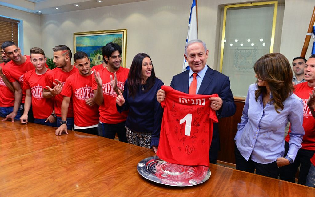 Prime Minister Benjamin Netanyahu and Culture and Sports Minister Miri Regev meet with Hapoel Beersheba F.C. soccer players and staff members in celebration of their winning the Israeli league championship, at the Prime Minister's Office in Jerusalem, May 24, 2016. (Kobi Gideon/GPO)