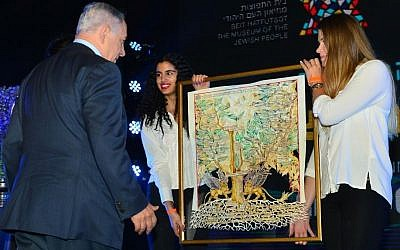 Prime Minister Benjamin Netanyahu is presented with a diagram of his family tree during the inauguration ceremony of a new section of Beit Hatfutsot, the Museum of the Jewish People, May 24, 2016. (Kobi Gideon/GPO)