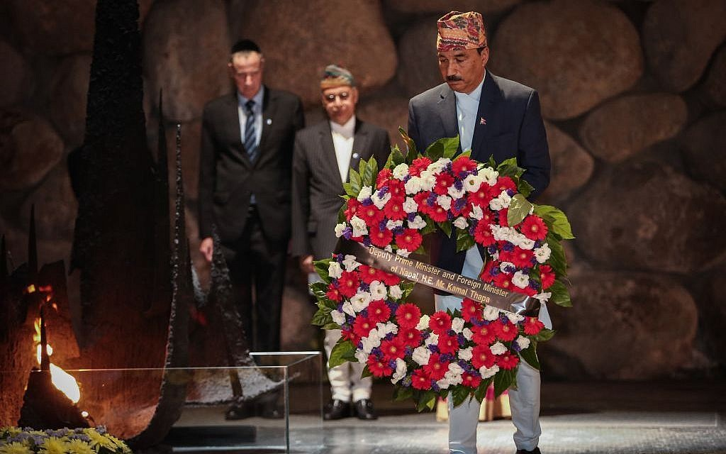 Deputy Prime Minister and Foreign Minister of Nepal, Kamal Thapa, lights the memorial torch during his visit to the Yad Vashem Holocaust Museum, in Jerusalem, on May 25, 2016. (Photo by Flash90)