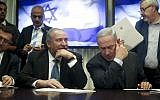 Prime Minister Benjamin Netanyahu (right) and leader of the Yisrael Beytenu political party Avigdor Liberman sign a coalition agreement in the Knesset on May 25, 2016 (Yonatan Sindel/FLASH90)