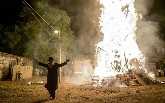 Ultra-Orthodox Jews seen near a big bonfire, during celebrations of the Jewish holiday of Lag Ba'Omer in neighborhood of Mea Shearim in Jerusalem on May 25, 2016.(Yonatan Sindel/Flash90)