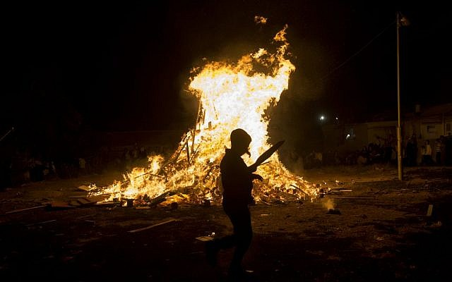 Ultra-Orthodox Jews seen near a big bonfire, during celebrations of the Jewish holiday of Lag B'Omer in the neighborhood of Mea Shearim in Jerusalem on May 25, 2016. (Yonatan Sindel/Flash90)