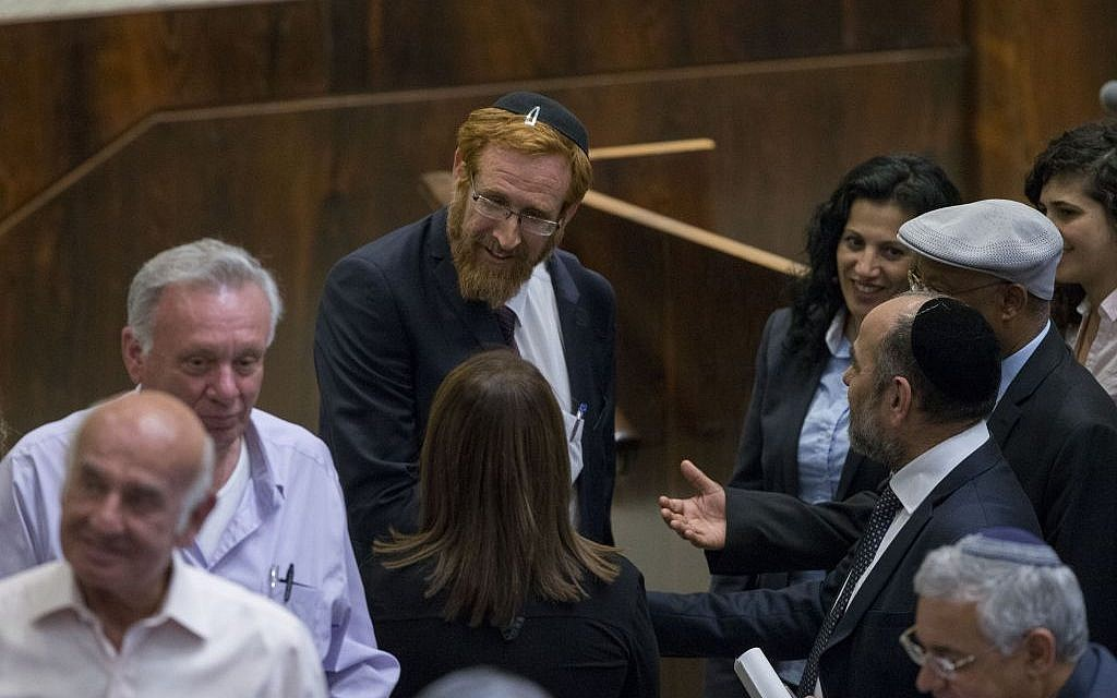 Likud MK Yehuda Glick is congratulate by fellow members of the Knesset after his swearing in, May 25, 2016. (Yonatan Sindel/Flash90)