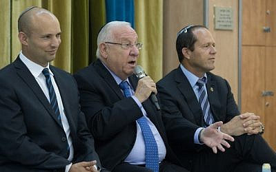 Israeli President Reuven Rivlin  with Education Minister Naftali Bennett and Jerusalem Mayor Nir Barkat during a meeting with high school students in Jerusalem, on May 29, 2016. (Yonatan Sindel/Flash90)