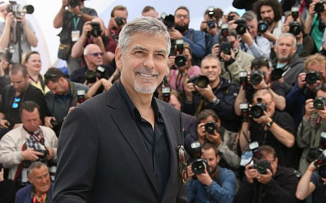 Actor George Clooney poses for photographers during a photo call for the film 'Money Monster' at the 69th international film festival, Cannes, France, May 12, 2016. (AP/Thibault Camus)