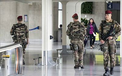 French soldiers patrol at Charles de Gaulle airport, outside of Paris, Friday, May 20, 2016. (AP Photo/Laurent Cipriani)