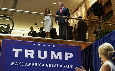 Donald Trump, accompanied by his wife, Melania, is applauded by his daughter Ivanka (right) as he's introduced before his announcement that he will run for president in the lobby of Trump Tower in New York, June 16, 2015. (AP/Richard Drew, File)