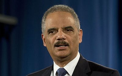 In this March 4, 2015 file photo, then-attorney general Eric Holder speaks at the Justice Department in Washington. (AP Photo/Carolyn Kaster)