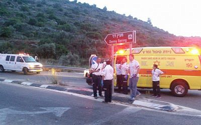 Israeli paramedics at the scene of a suspected car-ramming attack near the West Bank settlement of Dolev on May 3, 2016. (Magen David Adom)
