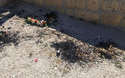 Wreaths that were destroyed and burned at the Mount of Olives cemetary in Jerusalem on Thursday, May 12, 2016 (Israel Police)